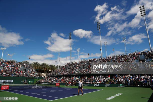 Denis Shapovalov of Canada serves against Marin Cilic of Croatia during their men's singles third round match on Day 9 of the BNP Paribas Open at the...