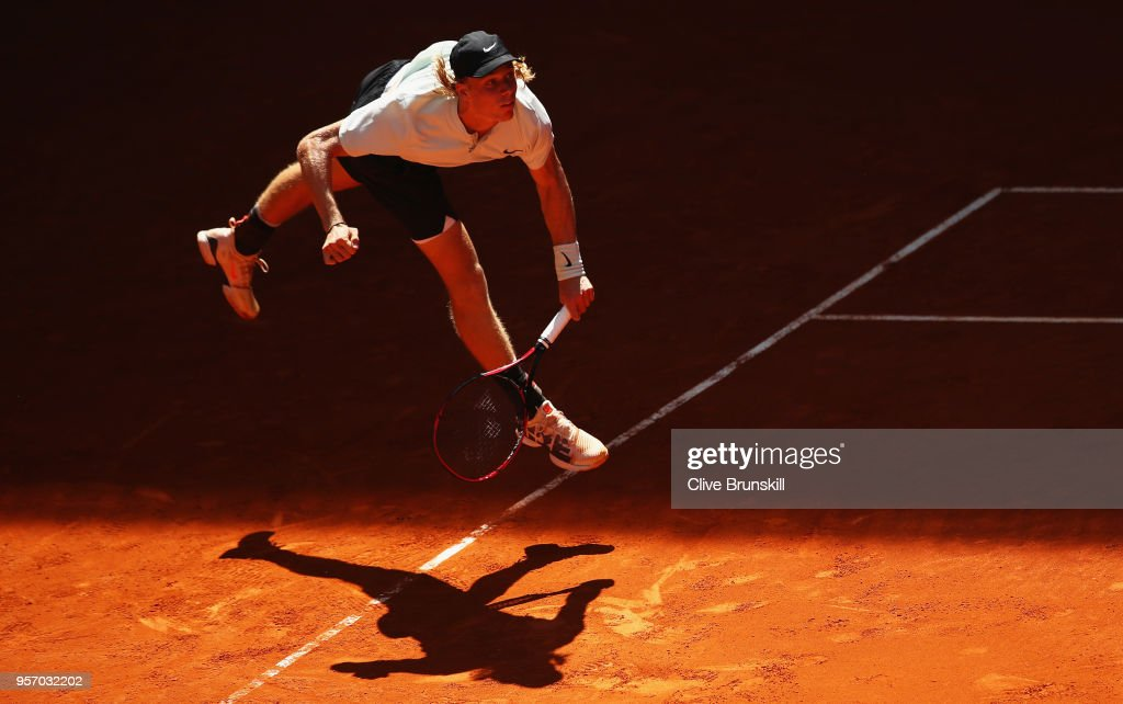 Denis Shapovalov of Canada serves against Milos Raonic of Canada in their third round match during day six of the Mutua Madrid Open tennis tournament at the Caja Magica on May 10, 2018 in Madrid, Spain.