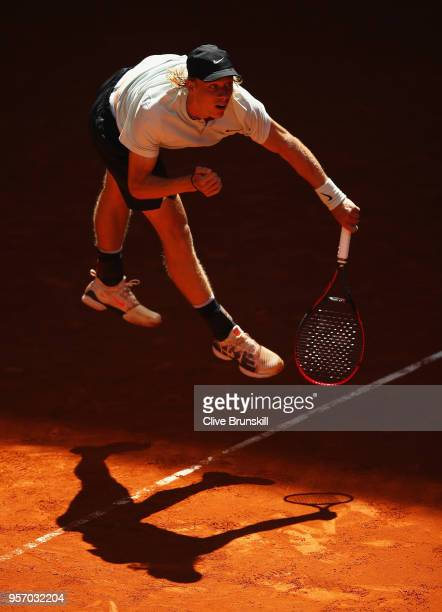 Denis Shapovalov of Canada serves against Milos Raonic of Canada in their third round match during day six of the Mutua Madrid Open tennis tournament...
