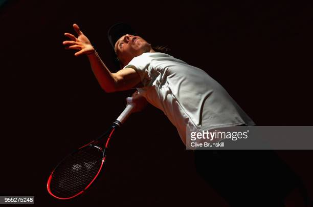 Denis Shapovalov of Canada serves against Tennys Sandgren of the United States in their first round match during day two of the Mutua Madrid Open...