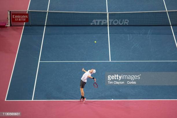 Denis Shapovalov of Canada serving against PierreHugues Herbert of France in the Men's QuarterFinal match during the Open Sud de France Tennis...