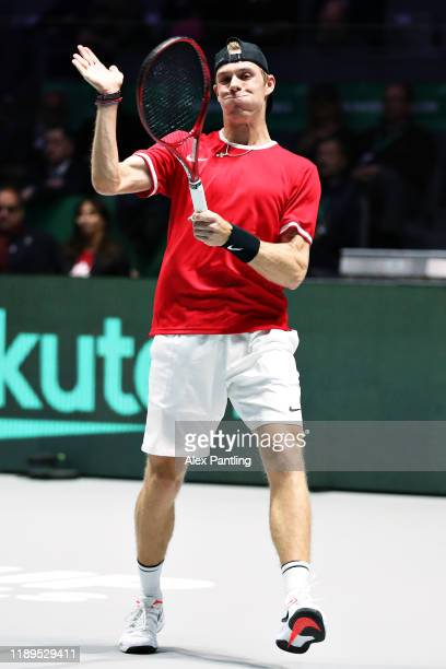 Denis Shapovalov of Canada shows his frustration by hitting his racket in his semi final singles match against Karen Khachanov of Russia during Day...