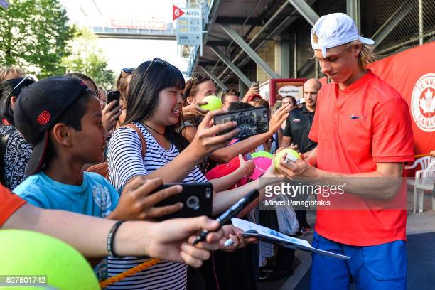 Denis Shapovalov of Canada signs autographs for fans after defeating Rogerio Dutra Silva of Brazil 46 76 64 during day five of the Rogers Cup...