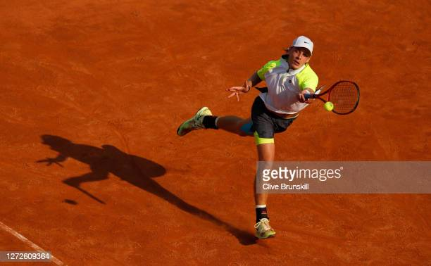 Denis Shapovalov of Canada stretches to play a forehand in his round one match against Guido Pella of Argentina during day two of the Internazionali...