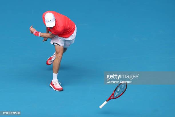 Denis Shapovalov of Canada throws his racquet during his Men's Singles first round match against Marton Fucsovics of Hungary on day one of the 2020...