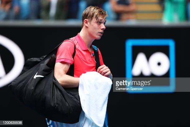 Denis Shapovalov of Canada walks off the court following defeat in his Men's Singles first round match against Marton Fucsovics of Hungary on day one...
