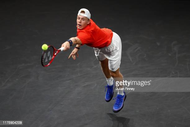 Denis Shapovalov of Team World stretches to play a backhand during his singles match against Dominic Thiem of Team Europe during Day One of the Laver...