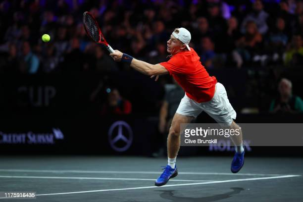 Denis Shapovalov of Team World stretches to play a forehand during his singles match against Dominic Thiem of Team Europe during Day One of the Laver...