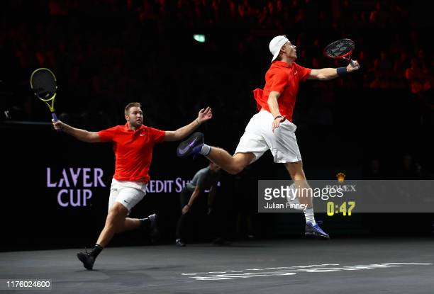 Denis Shapovalov, playing partner of Jack Sock of Team World jumps to play a forehand during their doubles match against Roger Federer and Alexander...