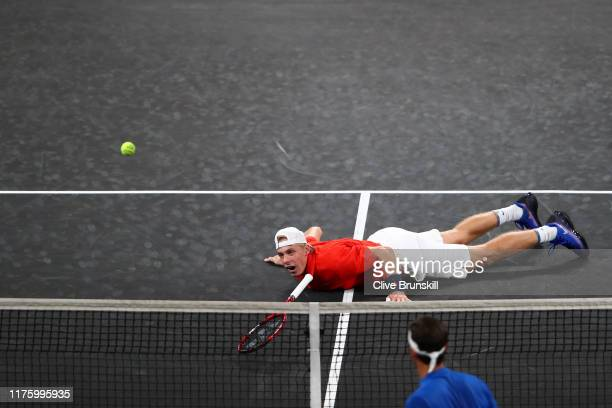 Denis Shapovalov, playing partner of Jack Sock of Team World reacts after diving to play a shot during their doubles match against Roger Federer and...