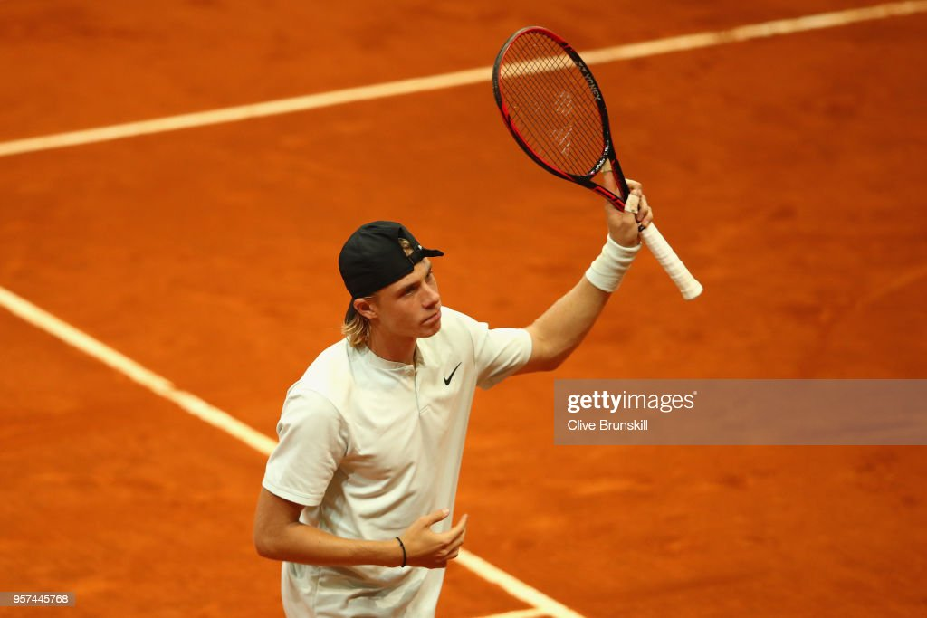 Denis Shapvalov of Canada celebrates match point against Kyle Edmund of Great Britain in their singles match during day seven of Mutua Madrid Open at La Caja Magica on May 11, 2018 in Madrid, Spain.