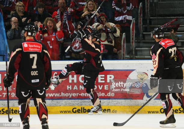 Denis Shvidki of Hannover celebrates after scoring his team's second goal during the DEL Bundesliga match between Hannover Scorpions and EHC Red Bull...