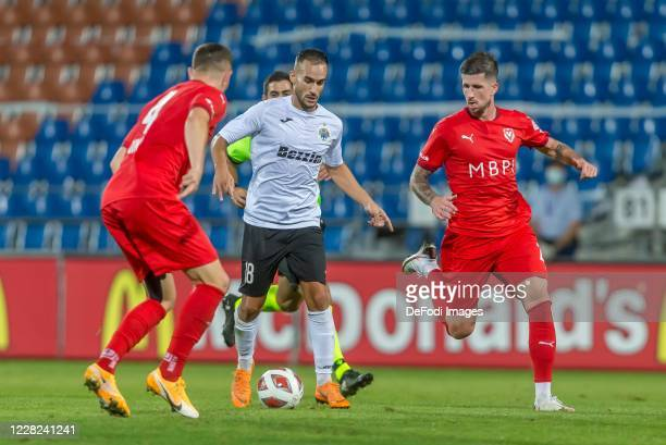 Denis Simani of FC Vaduz, Gabriel Izquier Artiles of Hibernians FC and Sandro Wieser of FC Vaduz battle for the ball during the UEFA Europa League...
