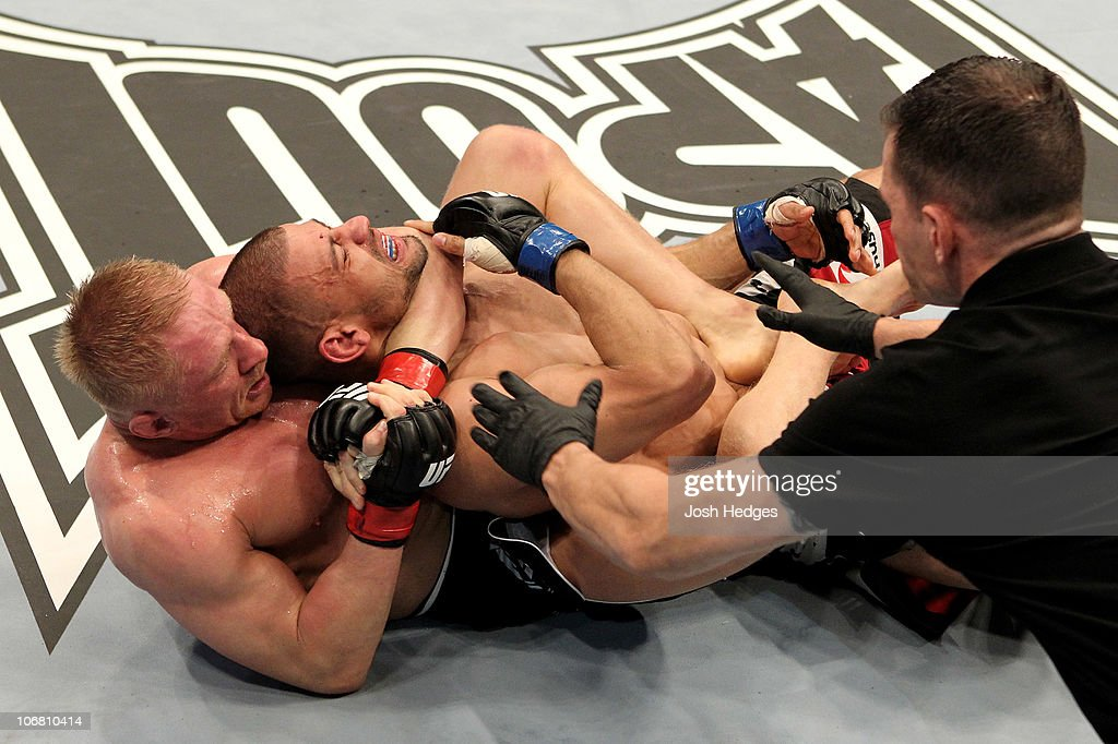 Denis Siver (L) of Germany fights Andre Winner of England during their UFC Lightweight bout at the Konig Pilsner Arena on November 13, 2010 in Oberhausen, Germany.