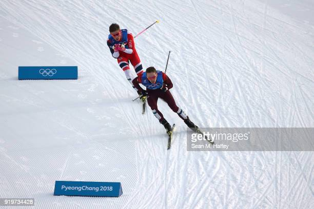 Denis Spitsov of Olympic Athlete from Russia and Johannes Hoesflot Klaebo of Norway compete during CrossCountry Skiing men's 4x10km relay on day nine...