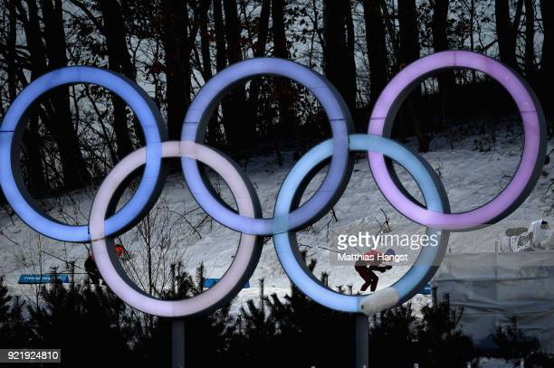 Denis Spitsov of Olympic Athlete from Russia passes the Olympic Rings as he competes during the Cross Country Men's Team Sprint Free semi final on...