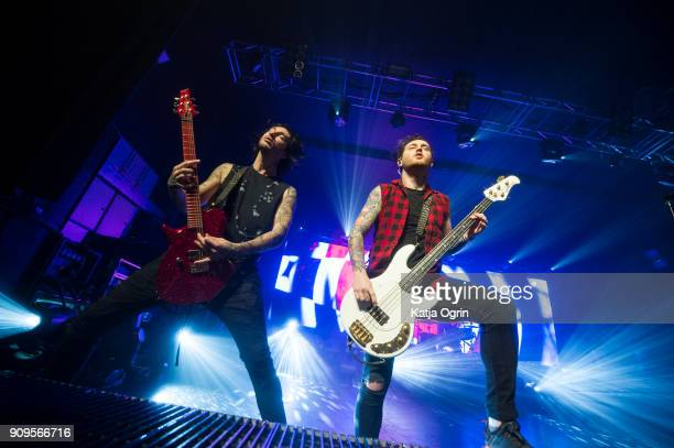Denis Stoff and Ben Bruce of Asking Alexandria perform live on stage at O2 Academy Birmingham on January 23, 2018 in Birmingham, England.