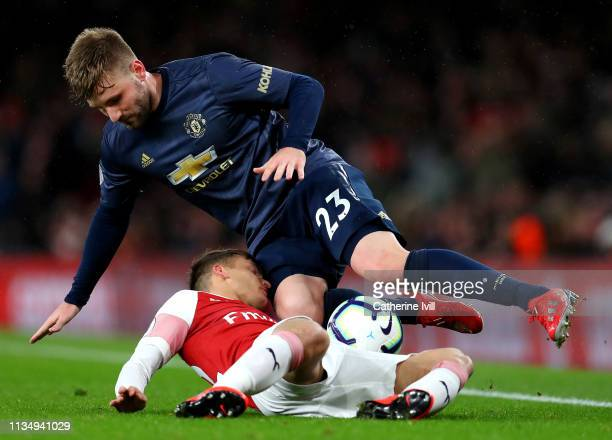 Denis Suarez of Arsenal battles for possession with Luke Shaw of Manchester United during the Premier League match between Arsenal FC and Manchester...