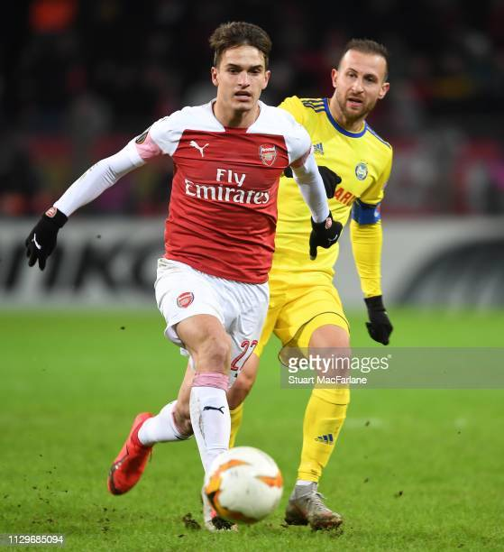 Denis Suarez of Arsenal breaks past Igor Stasevich of BATE during the UEFA Europa League Round of 32 First Leg match between BATE Borisov and Arsenal...