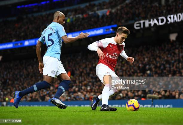 Denis Suarez of Arsenal gets away from Fernandinho of Manchester City during the Premier League match between Manchester City and Arsenal FC at...