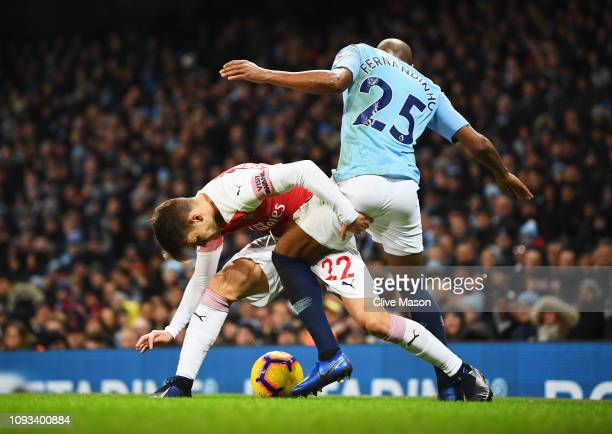 Denis Suarez of Arsenal tangles with Fernandinho of Manchester City during the Premier League match between Manchester City and Arsenal FC at Etihad...