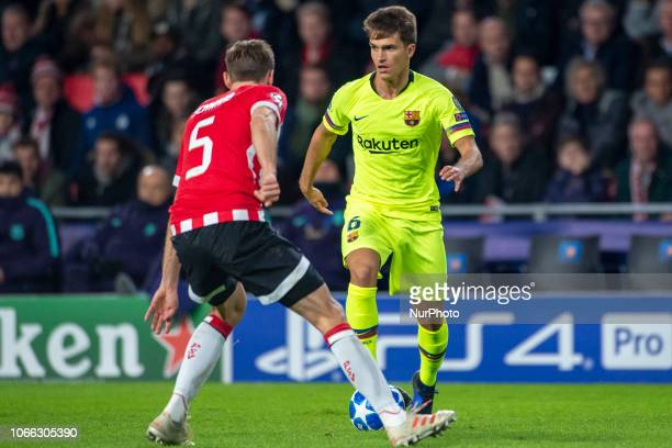 Denis Suarez of Barcelona and Daniel Schwaab of PSV during the UEFA Champions League Group B match between PSV Eindhoven and FC Barcelona at Philips...