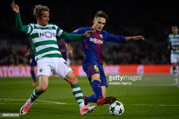 Denis Suarez of Barcelona in action against Fabio Coentrao of Sporting CP during the UEFA Champions League Group C soccer match between Barcelona and...