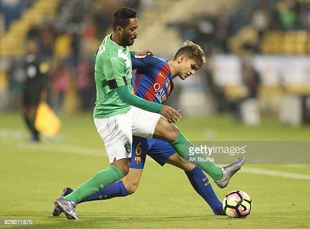 Denis Suarez of Barcelona in action against Fahad Hamad of Al-Ahli Saudi FC during the Qatar Airways Cup match between FC Barcelona and Al-Ahli Saudi...