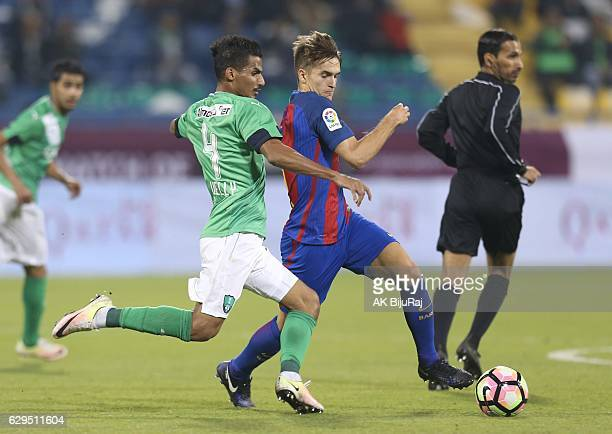 Denis Suarez of Barcelona tackled by Waleed Bakhween of Al-Ahli Saudi FC during the Qatar Airways Cup match between FC Barcelona and Al-Ahli Saudi FC...