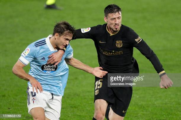Denis Suarez of Celta de Vigo, Clement Lenglet of FC Barcelona during the La Liga Santander match between Celta de Vigo v FC Barcelona at the Estadio...