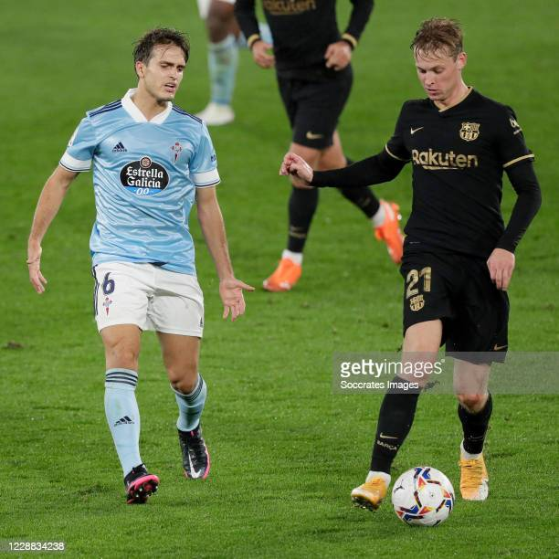 Denis Suarez of Celta de Vigo Frenkie de Jong of FC Barcelona during the La Liga Santander match between Celta de Vigo v FC Barcelona at the Estadio...