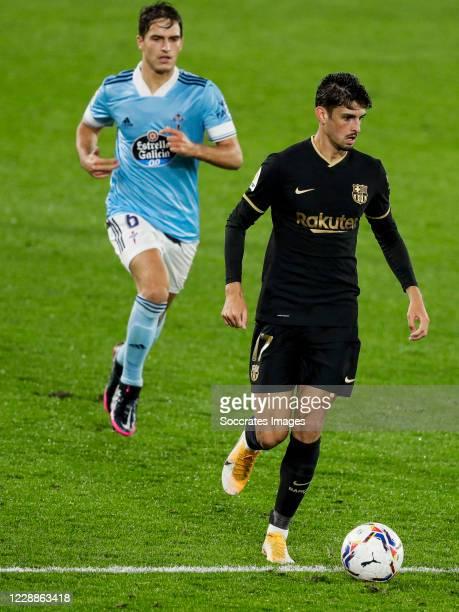 Denis Suarez of Celta de Vigo Trincao of FC Barcelona during the La Liga Santander match between Celta de Vigo v FC Barcelona at the Estadio de...