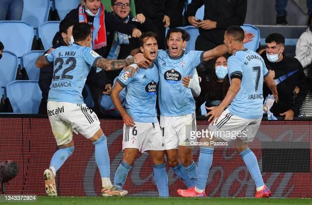 Denis Suarez of Celta Vigo celebrates with teammates after scoring their team's first goal during the LaLiga Santander match between RC Celta de Vigo...