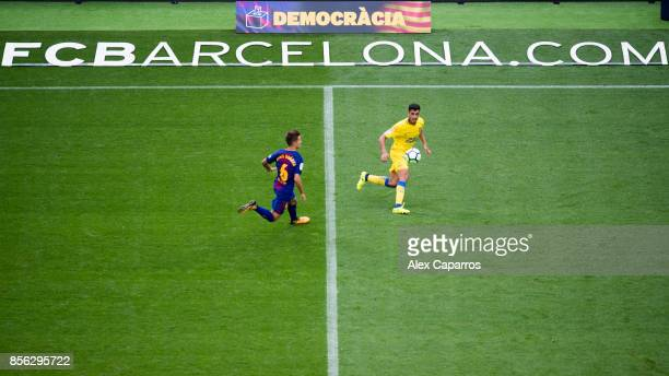 Denis Suarez of FC Barcelona and Borja Herrera of UD Las Palmas compete for the ball during the La Liga match between Barcelona and Las Palmas at...