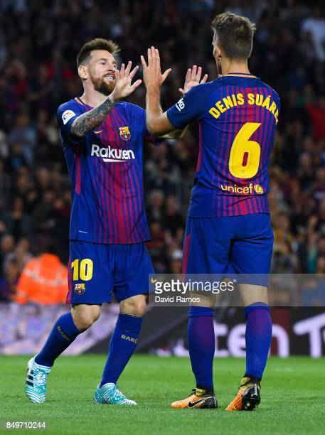 Denis Suarez of FC Barcelona celebrates with bis team mate Lionel Messi of FC Barcelona after scoring his team's third goal during the La Liga match...