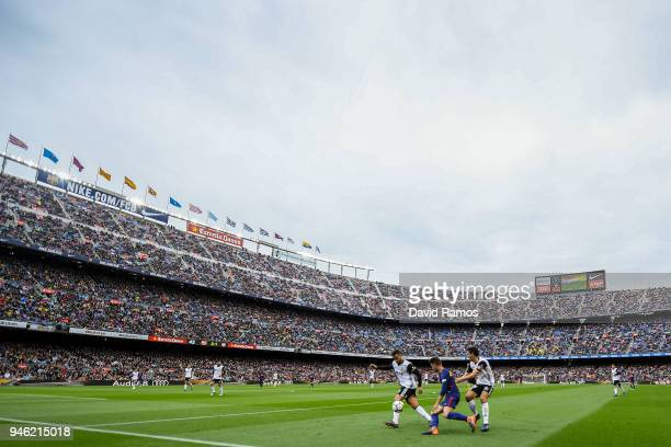Denis Suarez of FC Barcelona competes for the ball with Jeison Murillo and Dani Parejo of Valencia CF during the La Liga match between Barcelona and...