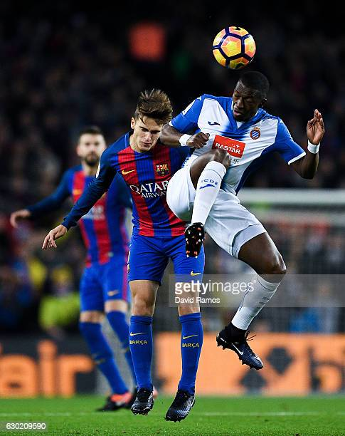 Denis Suarez of FC Barcelona competes for the ball with Pape diop of RCD Espanyol during the La Liga match between FC Barcelona and RCD Espanyol at...