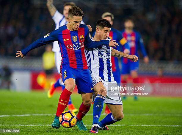 Denis Suarez of FC Barcelona duels for the ball with Yuri Berchiche of Real Sociedad during the La Liga match between Real Sociedad de Futbol and FC...
