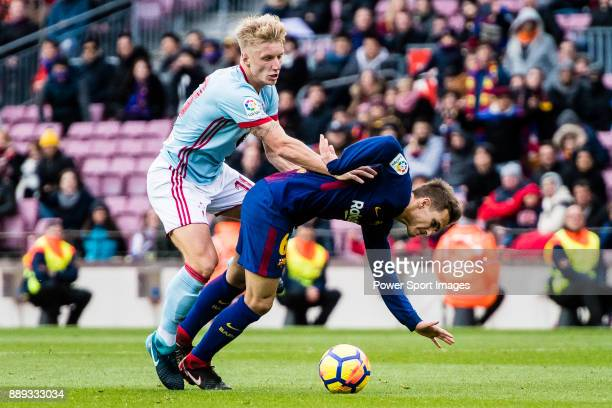 Denis Suarez of FC Barcelona fights for the ball with Daniel Wass of RC Celta de Vigo during the La Liga 201718 match between FC Barcelona and RC...