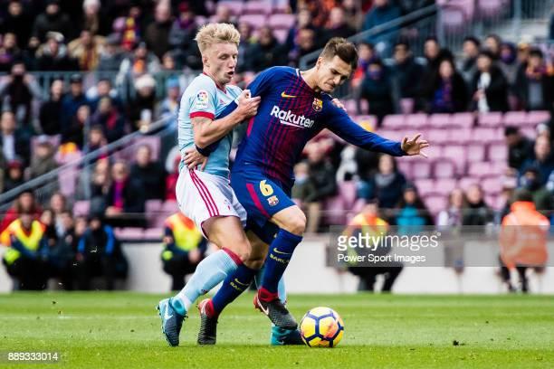 Denis Suarez of FC Barcelona in action against Daniel Wass of RC Celta de Vigo during the La Liga 201718 match between FC Barcelona and RC Celta de...
