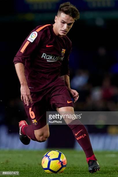 Denis Suarez of FC Barcelona runs with the ball during the La Liga game between Villarreal CF and FC Barcelona at Estadio de la Ceramica on December...