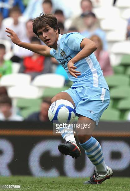 Denis Suarez of Manchester City passes the ball during the Dublin Super Cup match between Manchester City and Airtricity XI at Aviva Stadium on July...