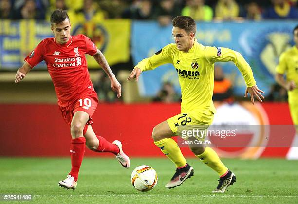 Denis Suarez of Villarreal and Coutinho of Liverpool in action during the UEFA Europa League semi final first leg match between Villarreal CF and...