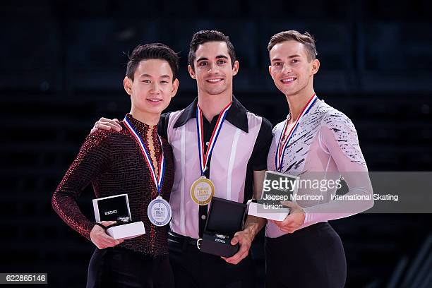 Denis Ten of Kazakhstan Javier Fernandez of Spain Adam Rippon of the United States pose during Men's Singles medal ceremony on day two of the Trophee...