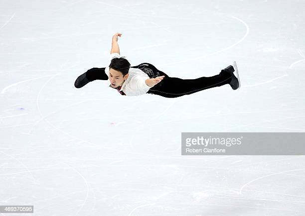 Denis Ten of Kazakhstan performs during the Figure Skating Men's Free Skating on day seven of the Sochi 2014 Winter Olympics at Iceberg Skating...