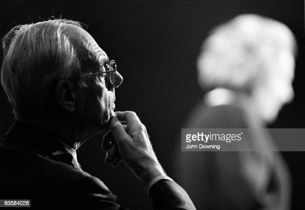 Denis Thatcher listens to his wife Margaret make a speech during her election campaign circa 1983