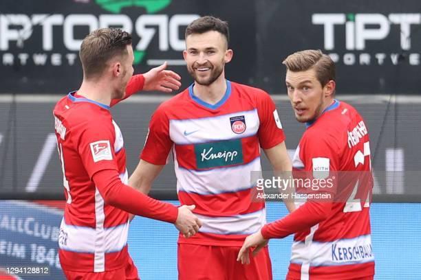 Denis Thomalla of Heidenheim celebrates scoring the opening goal during the Second Bundesliga match between 1. FC Heidenheim 1846 and 1. FC Nürnberg...