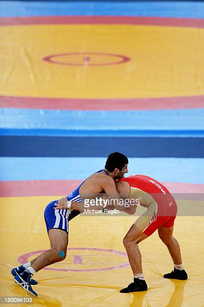 Denis Tsargush of Russia and Hasan Aliyev of Azerbaijan compete in the Men's Freestyle 74 kg Wrestling on Day 14 of the London 2012 Olympic Games at...