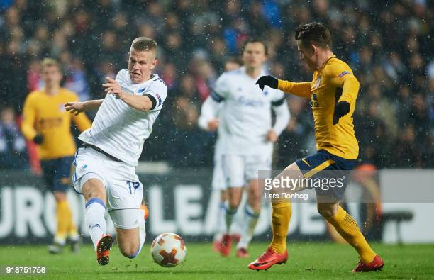 Denis Vavro of FC Copenhagen and Kevin Gameiro of Club Atletico de Madrid compete for the ball during the UEFA Europa League round of 32 1 leg match...