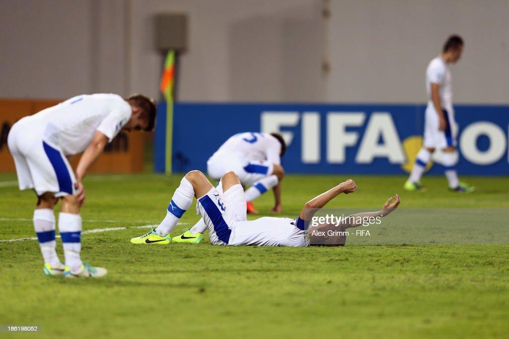Denis Vavro #3 of Slovakia and team mates react after the FIFA U-17 World Cup UAE 2013 Round of 16 match between Uruguay and Slovakia at Ras Al Khaimah Stadium on October 29, 2013 in Ras al Khaimah, United Arab Emirates.